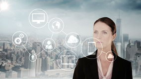 Businesswoman touching futuristic interface with city on background stock video