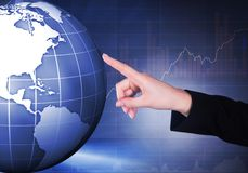 Businesswoman touching globe Royalty Free Stock Photo