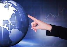 Businesswoman touching globe Royalty Free Stock Photo