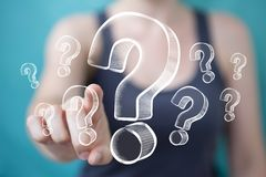 Businesswoman touching and holding hand drawn question marks Stock Photo