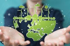 Businesswoman touching and holding renewable energy sketch. Businesswoman on blurred background touching and holding renewable energy sketch Royalty Free Stock Images
