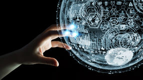 Businesswoman touching hologram sphere 3D rendering Royalty Free Stock Images