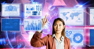 Businesswoman touching and interacting with technology interface panels. Digital composite of Businesswoman touching and interacting with technology interface Stock Photography