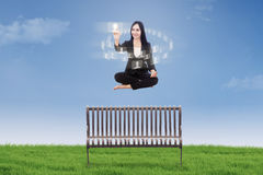 Businesswoman touching interface icon Royalty Free Stock Photography