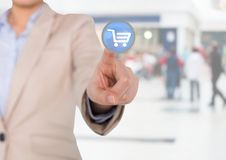 Businesswoman touching interface screen with shopping cart icon Royalty Free Stock Image