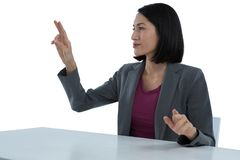 Businesswoman touching invisible screen Stock Image