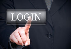 Login button. A businesswoman touching a login button - business, community, forum or online banking concept image stock photo