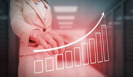 Businesswoman touching red bar chart and arrow graphic Royalty Free Stock Photography