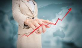 Businesswoman touching red growth arrow Stock Image