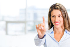 Businesswoman touching a screen Stock Images