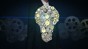 Businesswoman touching screen, big gears gathered idea bulb shape animation. stock video footage