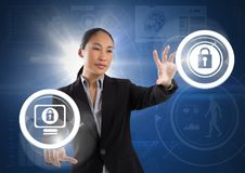 Businesswoman touching security lock icons. Digital composite of Businesswoman touching security lock icons Royalty Free Stock Images