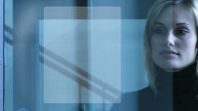 Businesswoman touching a security system stock footage