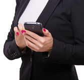 Businesswoman touching smartphone, holding in her hands Stock Images