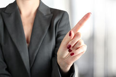 Businesswoman Touching something  by finger Royalty Free Stock Photos