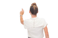 Businesswoman touching something Stock Image