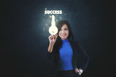 Businesswoman touching symbol of key Royalty Free Stock Images