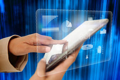 Businesswoman touching tablet with interface Stock Photography