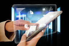 Businesswoman touching tablet with interface Stock Images