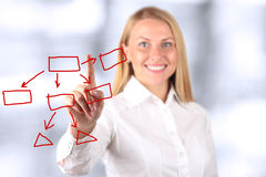 Businesswoman touching a virtual Graph by hand.  Blue backgro Stock Photo