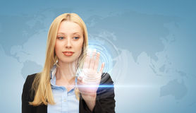 Businesswoman touching virtual screen Stock Images