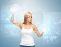 Businesswoman touching virtual screen Stock Photos