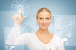 Businesswoman touching virtual screen Royalty Free Stock Photos