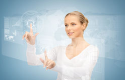 Businesswoman touching virtual screen Royalty Free Stock Image