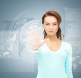 Businesswoman touching virtual screen Royalty Free Stock Photo