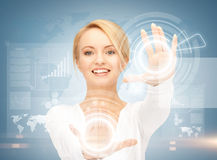 Businesswoman touching virtual screen Stock Photography