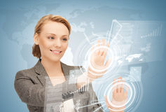 Businesswoman touching virtual screen Stock Photography