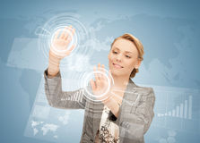 Businesswoman touching virtual screen Stock Image
