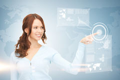 Businesswoman touching virtual screen Stock Image