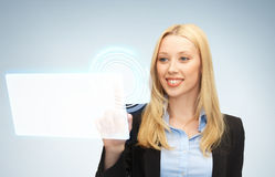 Businesswoman touching virtual screen Royalty Free Stock Photography