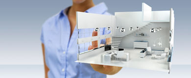 Businesswoman touching white 3D rendering apartment with her fin. Businesswoman on blurred background touching white 3D rendering apartment with her finger Royalty Free Stock Photography