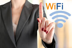 Businesswoman  touching a  word Wi Fi  Royalty Free Stock Photos