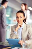 Businesswoman with touchpad Stock Image