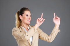 Businesswoman and touchscreen Stock Photo