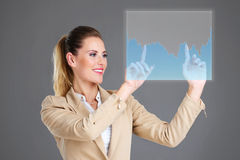 Businesswoman and touchscreen Stock Image