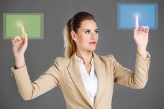 Businesswoman and touchscreen Stock Images