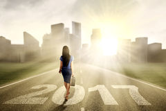 Businesswoman toward city with number 2017 Royalty Free Stock Photos