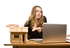 Businesswoman with  toy house at office Stock Photos