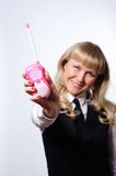 Businesswoman with toy pink transmitter Stock Image