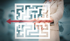 Businesswoman tracing red arrow through qr code Royalty Free Stock Image