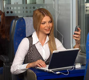 Businesswoman in train Stock Photos