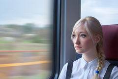 Businesswoman in train Stock Images
