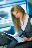 Businesswoman in train coupe Stock Photo