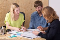 Businesswoman training her employees. Photo of professional businesswoman training her young employees Stock Images
