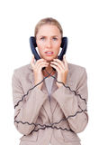 Businesswoman trangled up in telephone wires Royalty Free Stock Photos