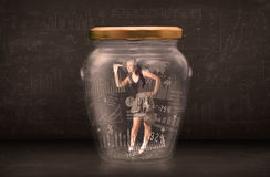 Businesswoman traped in jar with graph chart symbols concept Stock Photo